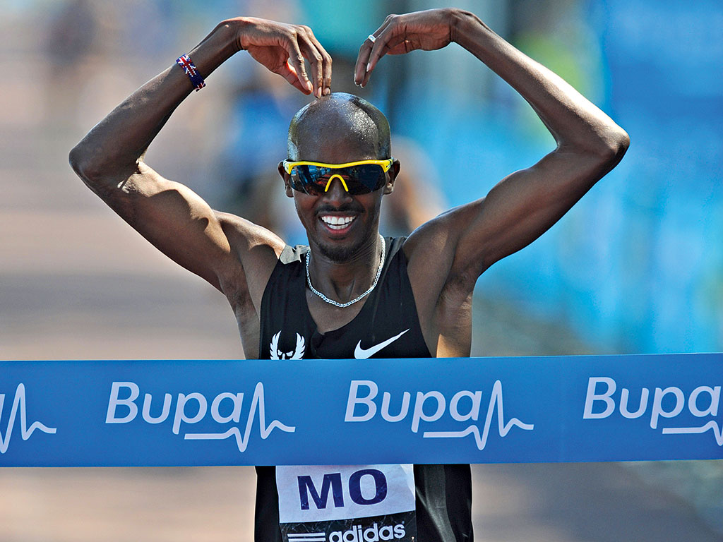 Mo Farah winning Bupa 10k last year. The running event is just one of many Bupa has put on to raise awareness of world health issues
