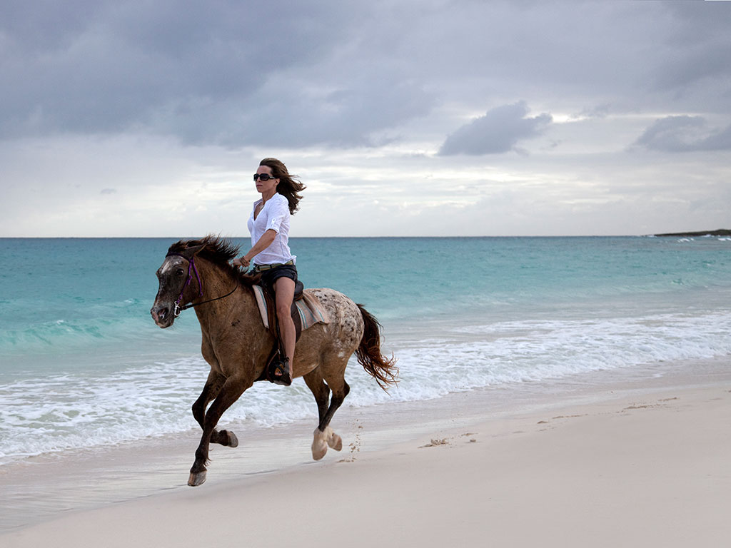 Visitors to Anguilla island have a variety of outdoor activities to choose from, including horseback riding along the beach