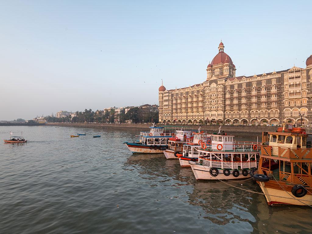 Boats in Mumbai harbor, with Taj Mahal hotel in the background
