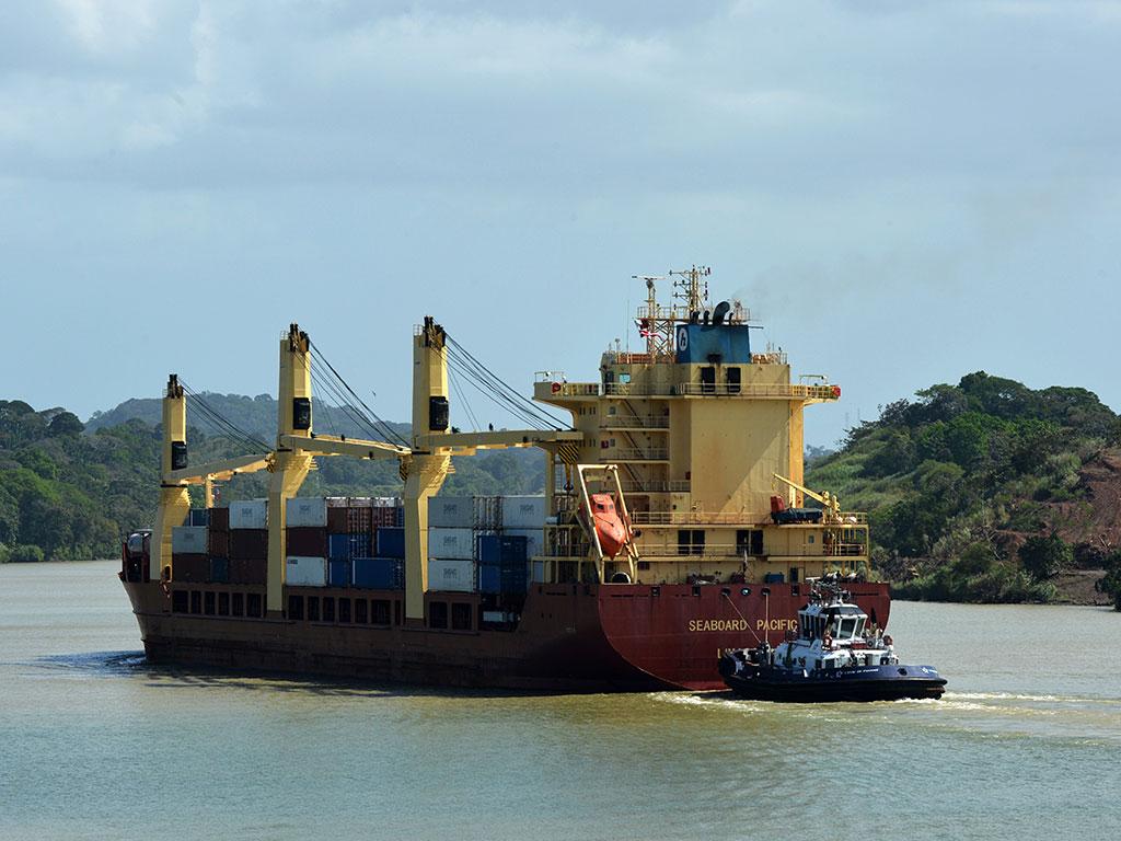 A cargo ship sails Corte Culebra in Gatun lake at the Panama Canal