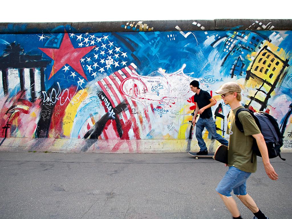 Skateboarders by the Berlin Wall