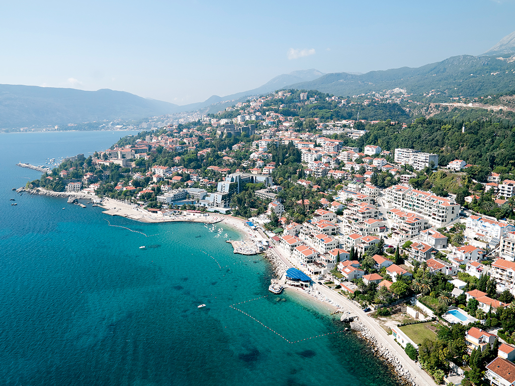 An aerial view of Herceg Novi, with historical medical town Igalo in the distance
