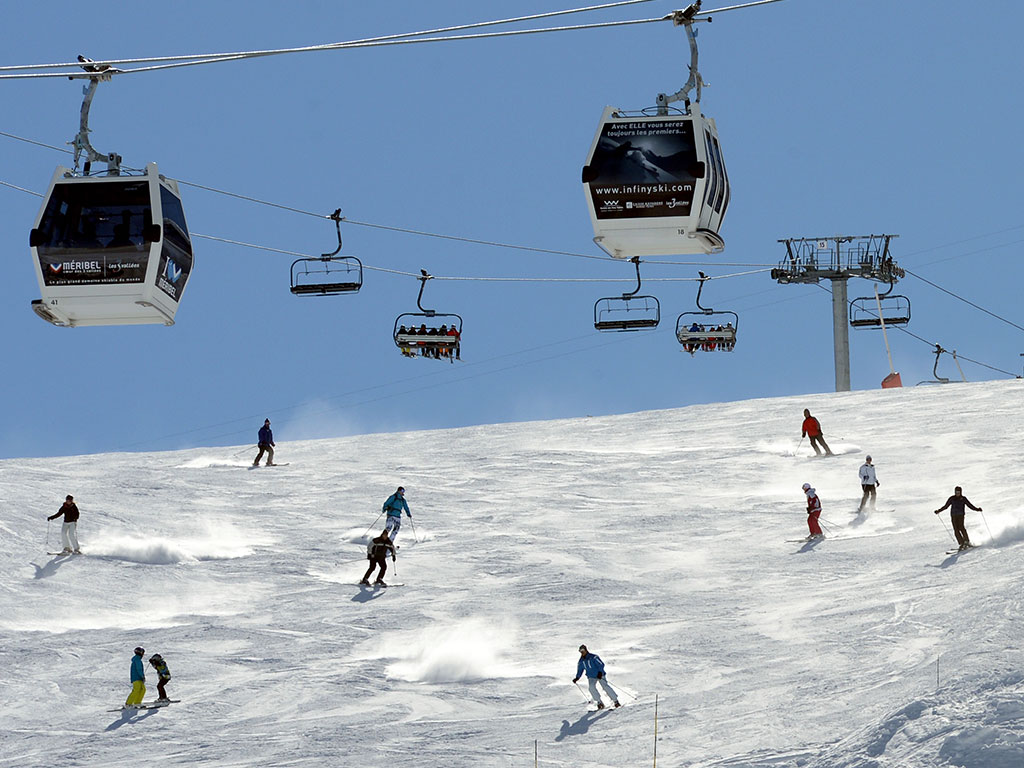People ski on a Meribel piste in the French Alps. The ski resort is set in the Tarentaise Valley, near the town of Moutiers