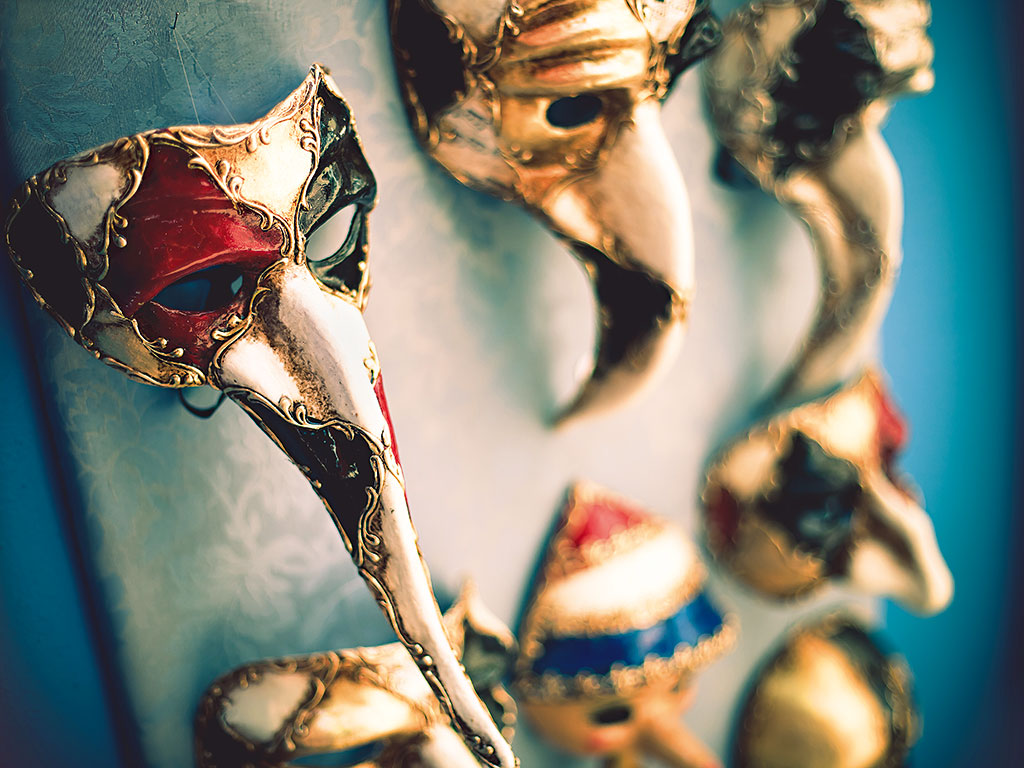 Venetian masks on display. Carnevale takes place at the beginning of the year and is famed elaborate masks and costumes
