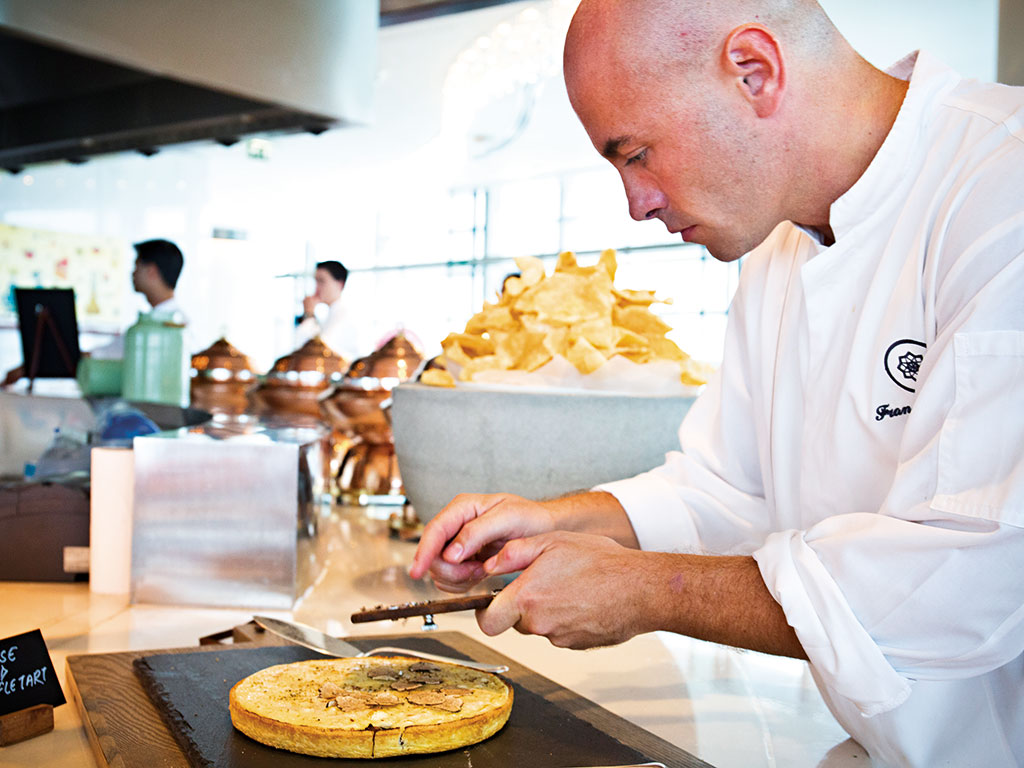 A chef prepares food at Rosewood Abu Dhabi. The hotel has several restaurants to choose from