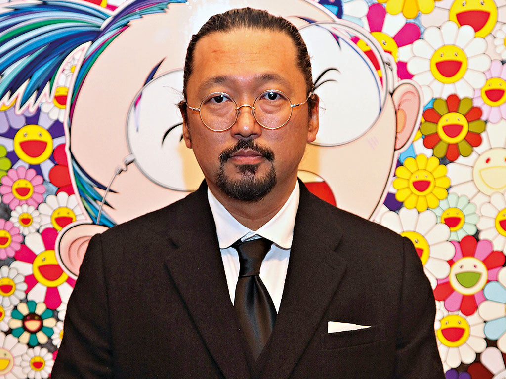 Artist Takashi Murakami poses in front of New day: Face of the Artist