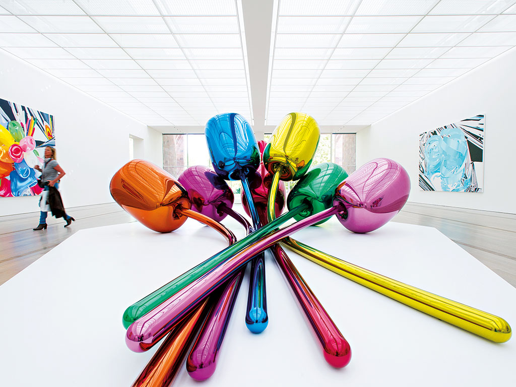 Jeff Koons' Tulips exhibited in Basel. The artist formerly worked as a Wall Street commodities broker, which many think has helped him make money in the art world