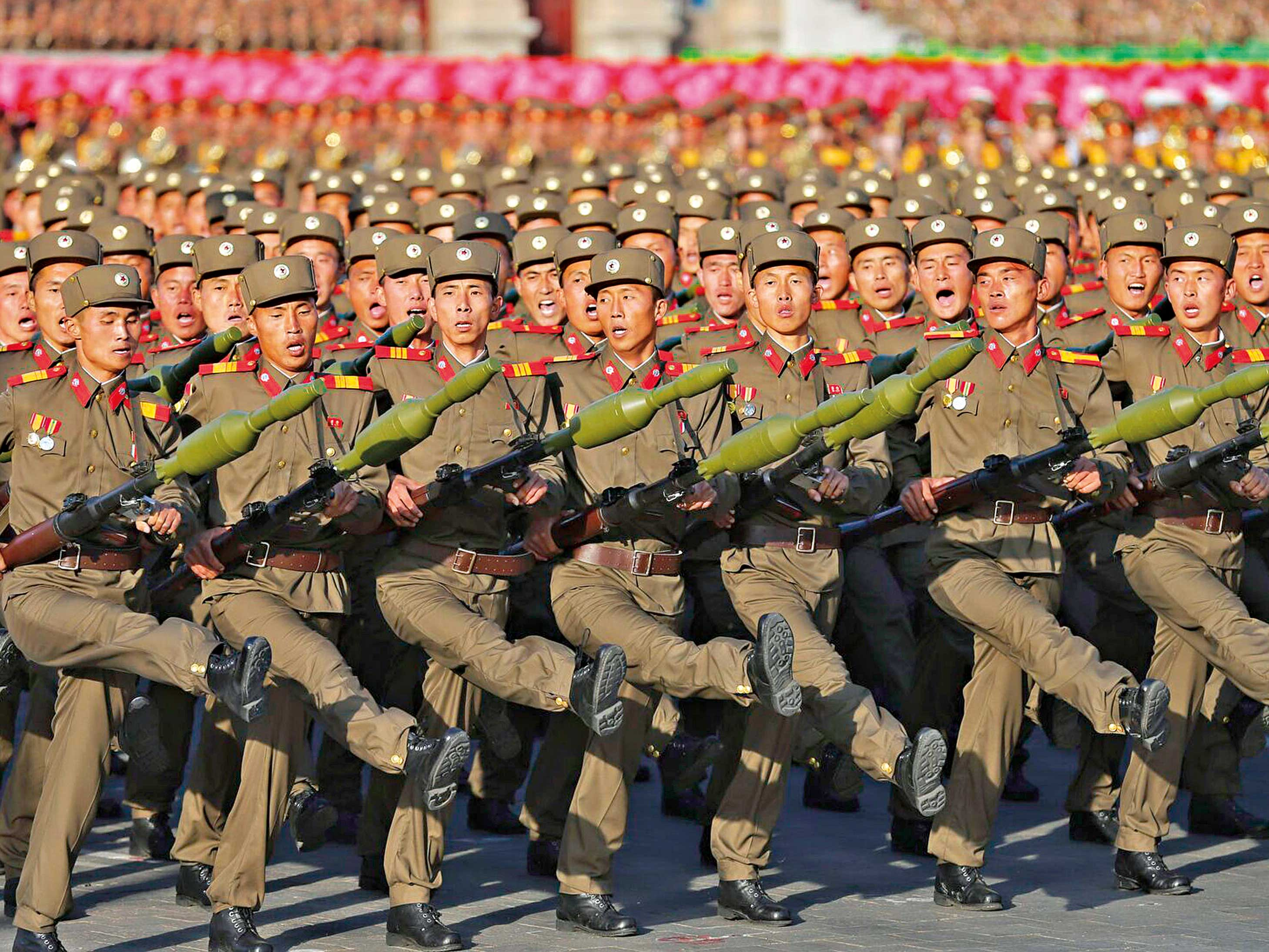 The North Korean army displays its infamous goose step march