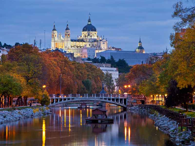 Madrid's Catedral de la Almudena overlooks Manzanares river. Each year, the Spanish capital welcomes more than one million business tourists