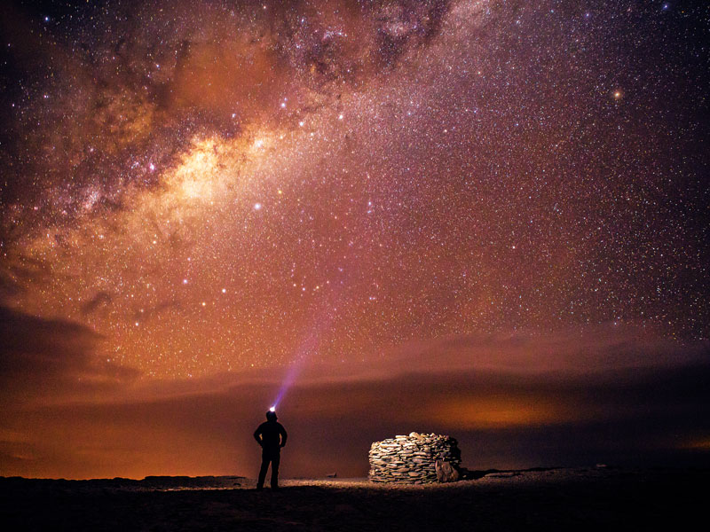 A traveller stands under the Milky Way in the Atacama Desert, Northern Chile