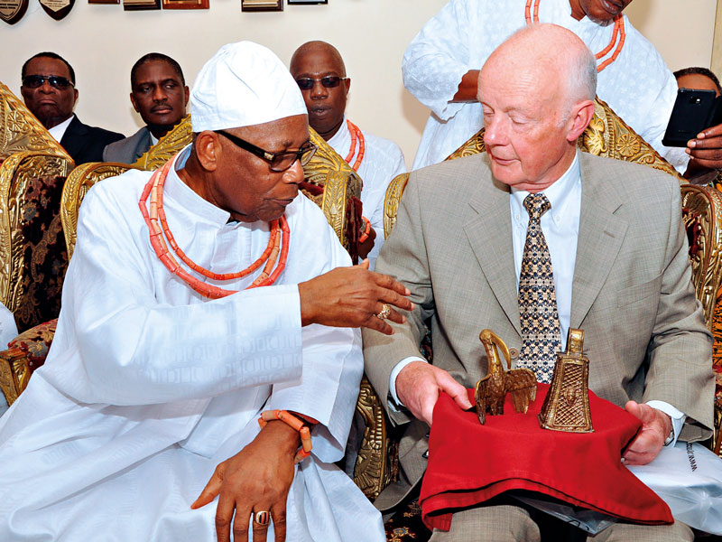 Prince Edun Akenzua (left) speaking to Mark Walker (right), who returned two bronze artefacts to the Benin kingdom after he inherited them