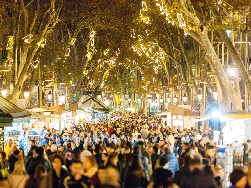 Throngs of people at the La Rambla Christmas market in Barcelona. Last summer, anti-tourism activists slashed the tyres of tour buses in the city in protest of increasing tourist numbers