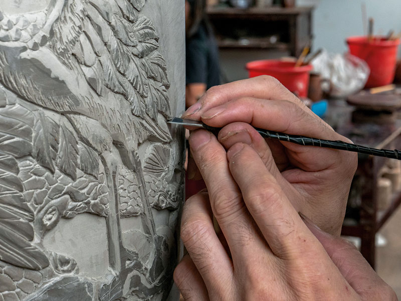 A craftsman working to create Rongchang County's famous pottery