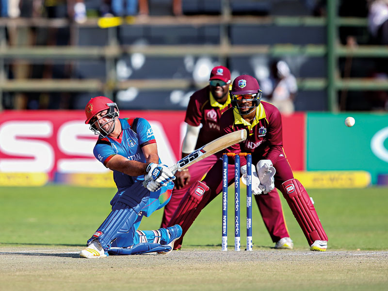 Samiullah Shinwari of Afghanistan scores runs during the ICC Cricket World Cup Qualifier final between the West Indies and Afghanistan