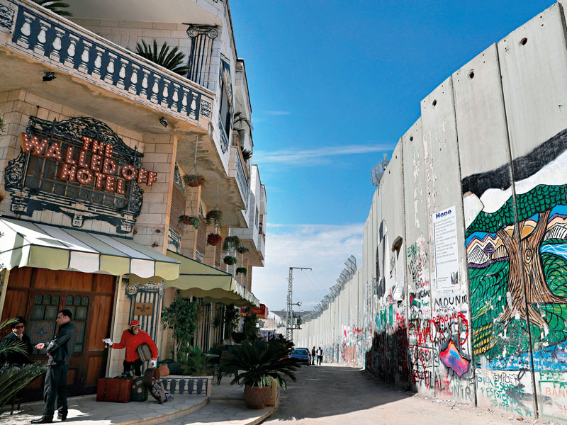 "The Walled Off Hotel is located mere steps from the Israeli West Bank barrier, built by Israel to annex Palestine. The hotel is described by its owner as having the ""worst view in the world"""